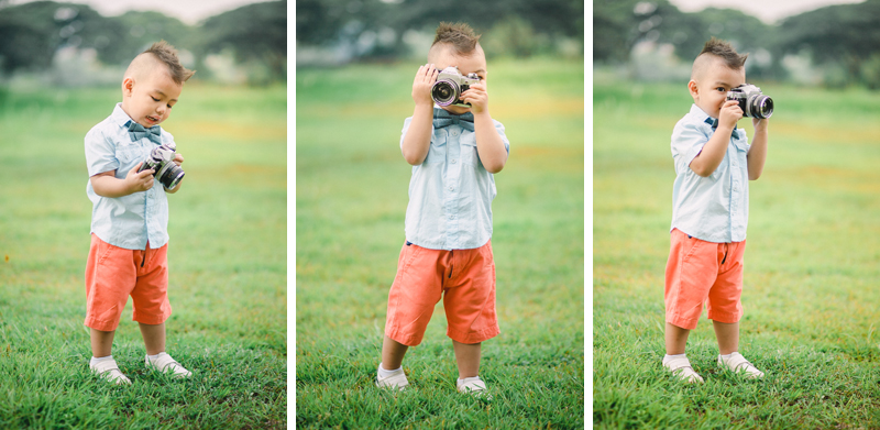 Pre-birthday Baby Photography of Shaun holding a camera